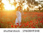 Happy Girl Stands In A Poppy...