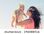 Portrait Of Young Mother And...