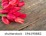Tulips On Wooden Surface