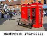 Two Red Telephone Boxes And A...