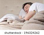 Man Peacefully Sleeping In A...
