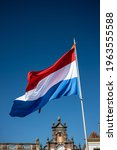 Kings Day in the Netherlands with the red white and blue flag of the Netherlands fluttering in the wind