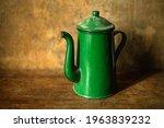 A Green Enameled Metal Teapot...