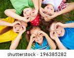 group of cute children lying on ... | Shutterstock . vector #196385282