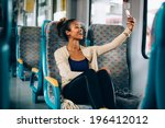 young woman taking a selfie on... | Shutterstock . vector #196412012