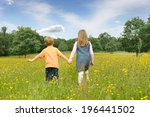 brother and sister holding... | Shutterstock . vector #196441502