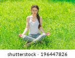 young woman sitting in a lotus...   Shutterstock . vector #196447826