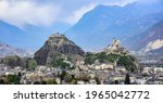 Panoramic view of historical Sion town with its two castles, Chateau de Tourbillon and Valere Basilica, spectacular set in the swiss Alps mountains valley, canton Valais, Switzerland