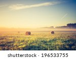 hay bales on foggy morning on... | Shutterstock . vector #196533755