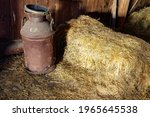 An Old Rusty Milk Can And A...