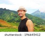 happy traveler in the mountains | Shutterstock . vector #196645412