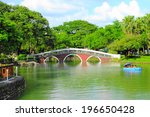 red bridge and green lake at... | Shutterstock . vector #196650428