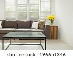Grey Sofa With Pillows In Fron...