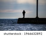 Silhouette Of A Man Fishing Off ...