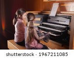Two Little Girls Play The Organ ...