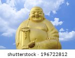 Gold  Buddha  On A Blue Sky...