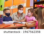 Childminder And Children With...