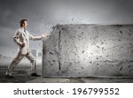 businessman breaking stone wall ... | Shutterstock . vector #196799552