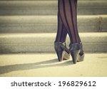 back of a woman's legs wearing