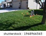 A Yard Covered In Utility Flags ...