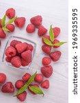 Bowl Of Fresh Raspberries With...