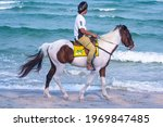 Horse Riding On The Beach In...