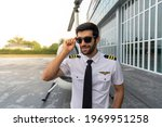 Young Male Pilot Standing Next...