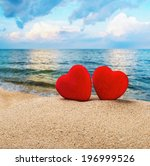 Two Red Hearts In The Sand On...
