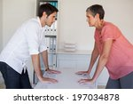 casual business team facing off ... | Shutterstock . vector #197034878