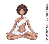 Young Meditating Yogi Woman In...