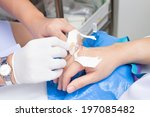 iv solution in a patient hand | Shutterstock . vector #197085482