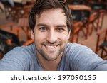 young handsome man taking selfie | Shutterstock . vector #197090135