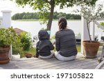 mother with son sitting on... | Shutterstock . vector #197105822