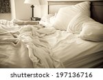 an unmade bed with white linens ... | Shutterstock . vector #197136716