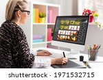 Woman working with digital photo library on desktop computer and editing photos