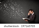 young man reading a book while... | Shutterstock . vector #197165705