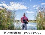 Caucasian Male Fishing In A...