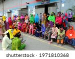 Small photo of Garments workers of Binni Garments limited stage a roadblock demonstration demanding their due wage and festival bonus in Dhaka, Bangladesh, on May 11, 2021