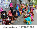 Small photo of Dhaka, Bangladesh- May 11, 2021: Garment workers of Binni Garments Ltd block the road in front of the factory to demanding payment of due wages and Eid bonus, in Dhaka, Bangladesh.