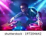 young energetic dj mixing music ... | Shutterstock . vector #197204642