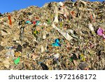 Small photo of Garbage dump with construction waste. Trash disposal and food waste. Recycling of waste at junk yard. Dispose the rubbish in landfill. Trash disposal and rubbish dump with polution. Ecology concept