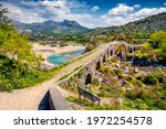 Amazing spring view of Old Mes Bridge. Stunning morning landscape of Shkoder. Picturesque outdoor scene of Albania, Europe. Traveling concept background.