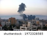 Small photo of Israeli air strikes on residential buildings and towers in Gaza City, on May 12, 2021. At least 35 people were killed in Gaza and five in Israel as tensions have escalated in the region.