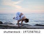 Caucasian Woman Doing Yoga...