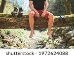 Man Sitting On The Fallen Tree ...