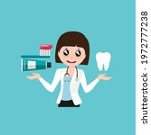 cartoon dentist and toothbrush. ... | Shutterstock .eps vector #1972777238