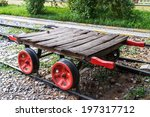 Small photo of Wagonette on railway with red wheels.