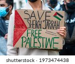 Small photo of London, UK. 11th May 2021. Protester with sign at the Save Sheikh Jarrah rally for a Free Palestine, urging the UK government to take immediate action and stop allowing Israel to act with impunity.
