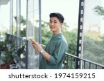 Young Man With Mobile Phone At...