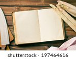the recipe book and white asparagus - stock photo